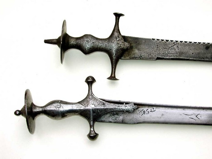 Two Indian Tulwar swords with spearpoint blade and calligraphy