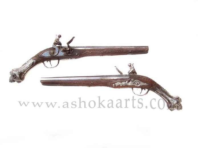 A pair of Fine Silver and Niello mounted Turkish or Balkan flintlocks pistols