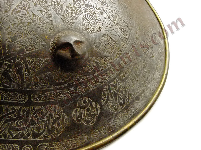 Persian Qajar steel shield dhal with embossed faces and gold damascene
